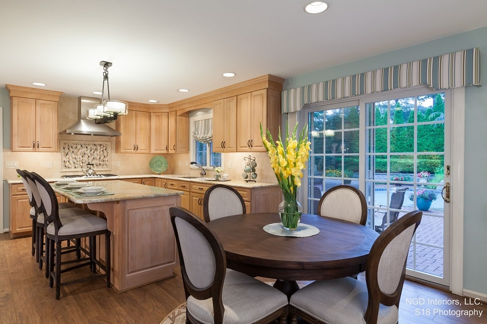 Traditional Eat in Kitchen Refresh featuring light alder wood cabinetry, granite countertops, oil rubbed bronze finishes and dark wood accents