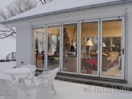 During the winter time the NanaWall is structurally sound and insulated to use the room all year long, even during the coldest winter months.